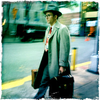 Dapper Man in Retro Suit,tie and Hat with Brief case
