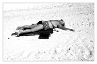 Black and White Photo of woman tanning on the Beach