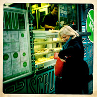 Woman buying Sweets from a Food Truck