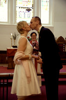Bride and Groom Kiss at Ceremony in Finnish Church NYC