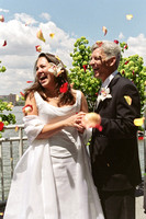 Surprise toss of Rose Petals at Wedding Ceremony